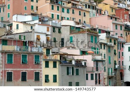 Colorful houses in the Italian seaside village of Riomaggiore in the Cinque Terre - stock photo