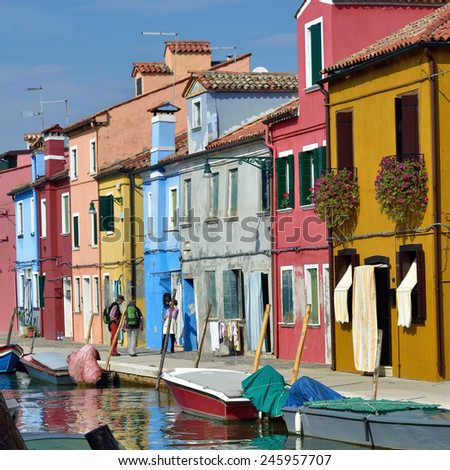Colorful houses on the famous island Burano. Venice and the Venetian lagoon are on the UNESCO World Heritage List - stock photo