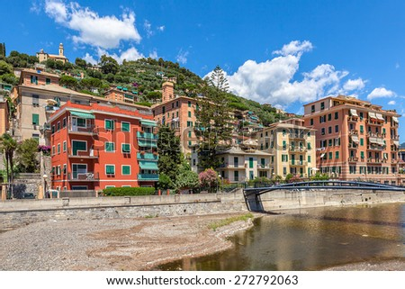 Colorful houses under blue sky in town of Recco, Italy. - stock photo