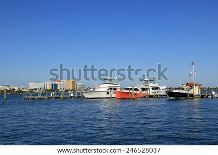 Colorful hulls on expensive boats in Palm Beach, Florida - stock photo