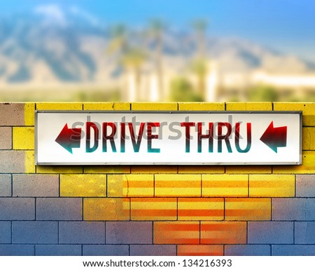 Colorful image of an old drive thru sign on wall - stock photo