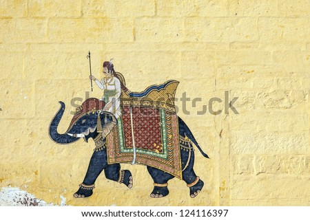 colorful indian mural in the fort at Jodhpur showing a royal procession, including elephant  from the Rajput era - stock photo