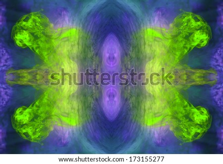 Colorful ink forming patterns resembling Rorschach Test ink blots.  - stock photo