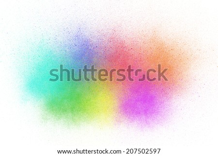 Colorful ink sprayed on white background. - stock photo