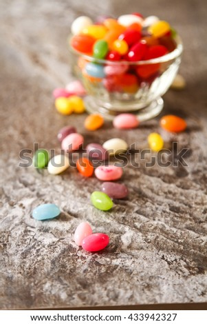 Colorful Jelly Beans (close-up shot) on background stone. - stock photo
