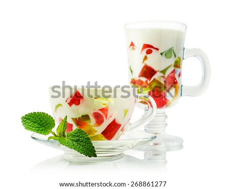 Colorful jelly dessert in a glasses with mint over white - stock photo
