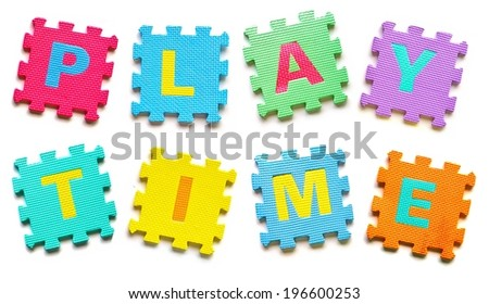 colorful jigsaws arranged as a word play time - stock photo