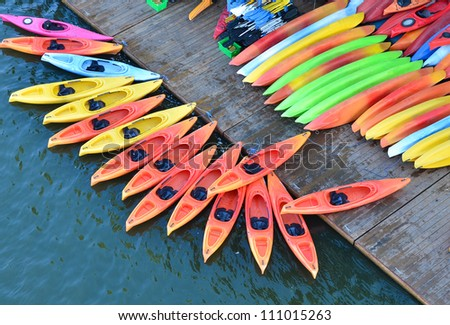 Colorful kayaks docked - as seen from above - stock photo