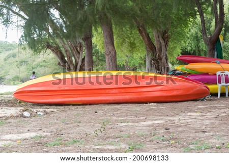 Colorful kayaks in stack - stock photo