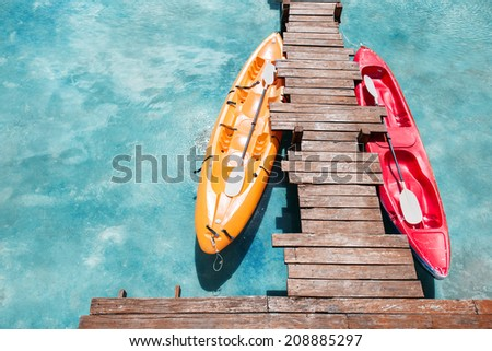 Colorful kayaks in the big pool - stock photo