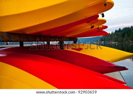 Colorful kayaks on Hood Canal pier - stock photo