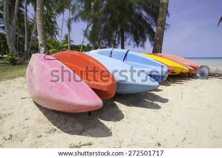 Colorful kayaks on the beach. soft-focus. Koh kood. Thailand - stock photo