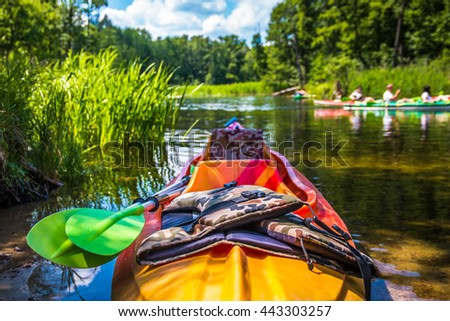 Colorful kayaks on the river trail Kruty?. Poland - stock photo