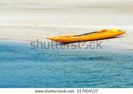 Colorful kayaks on white sand beach in Koh Kood Island ,Thailand - stock photo
