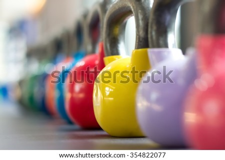 colorful kettlebell lining on table - stock photo