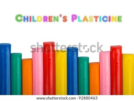 Colorful kids plasticine on white background - stock photo