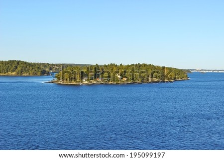 Colorful landscape of Baltic sea with island near coastline of Sweden - stock photo