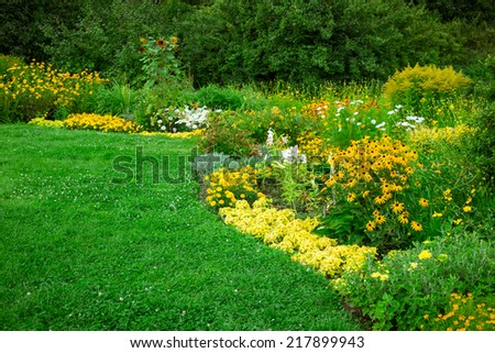 Colorful landscaped formal garden. Beautiful blooming Garden. - stock photo