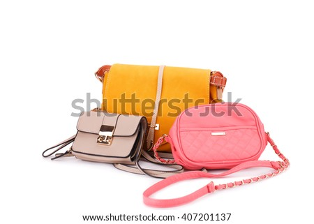Colorful leather bags isolated on white background. - stock photo