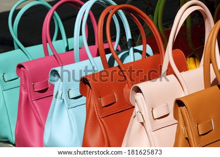 colorful leather handbags collection on San Lorenzo market in  Florence, Italy - stock photo