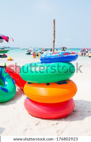 colorful life buoy on the beach at koh lan - stock photo