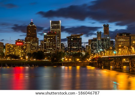 Colorful lights reflecting off the Willamette River in Downtown Portland, Oregon - stock photo