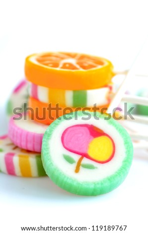 Colorful lollipops isolated on the white - stock photo