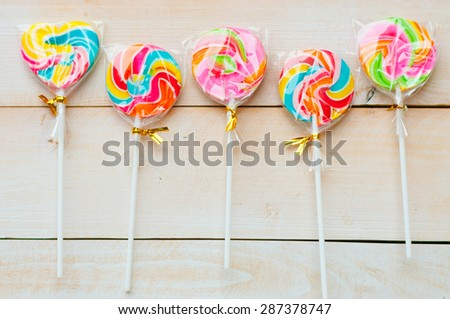 colorful lollipops on white background - stock photo