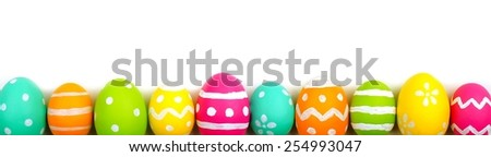 Colorful long Easter egg border against a white background - stock photo