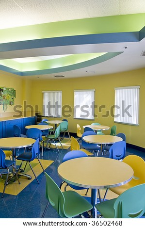 Colorful Lunch Room With Tables Chairs and Coffe Bar - stock photo