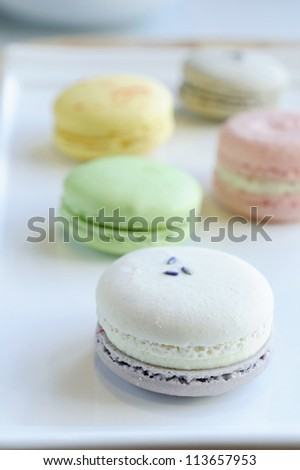 Colorful Macaron on dish - stock photo