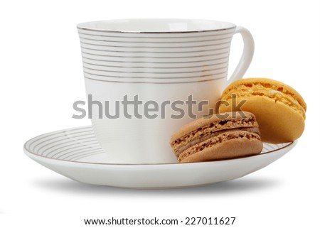 Colorful macarons and coffee cup - isolated on white background  - stock photo