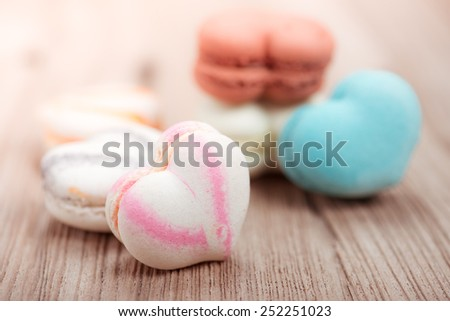 colorful macarons in heart shape  with vintage pastel filtered - stock photo