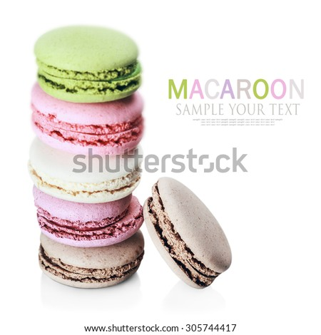 Colorful macaroon stack isolated on white background. Focusna cake at the bottom of the frame. Text example - stock photo
