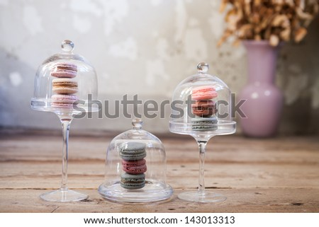 Colorful macaroons, delicious French pastries, stacked on table.  - stock photo