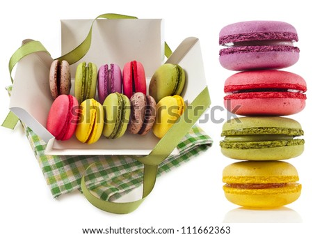 Colorful macaroons in a paper box and tower stack isolation on a white background - stock photo