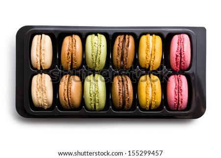 colorful macaroons in plastick box on white background - stock photo