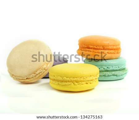 Colorful macaroons on white isolated background - stock photo