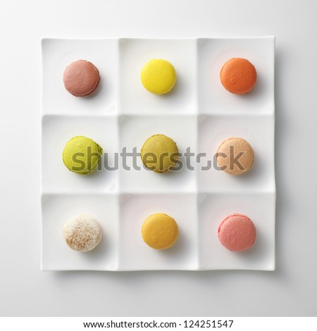 colorful macaroons on white plate - stock photo