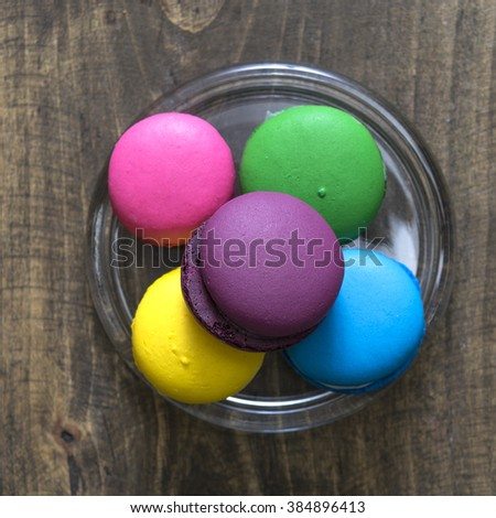 Colorful macaroons  on wooden background, from above - stock photo