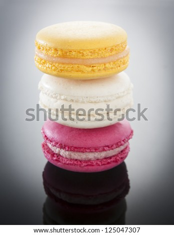 Colorful macaroons stacked on a gradient background - stock photo