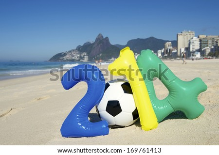 Colorful 2014 message with inflatable numbers and soccer ball football on Ipanema Beach Rio de Janeiro Brazil - stock photo
