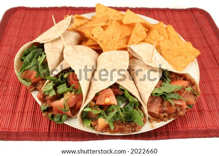 colorful mexican fajitas, and crunchy nacho chips - stock photo