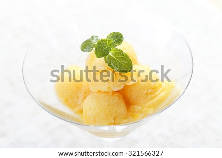 Colorful Mix fruit sorbet in cocktail glass. - stock photo