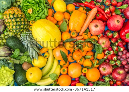 Colorful mix of fruits and vegetables background - Assortment of fresh and natural food sorted by color  - stock photo