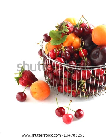 Colorful mixed summer fruit isolated over white - stock photo