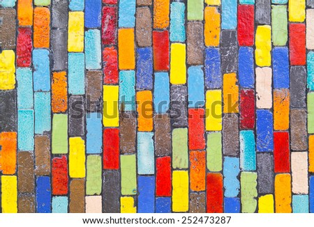 Colorful mosaic texture on the wall background - stock photo