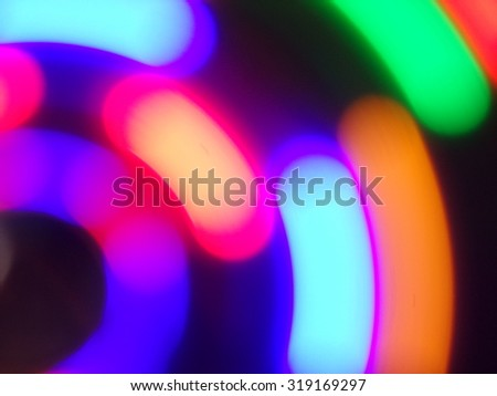 Colorful moving bokeh circles background - stock photo