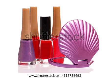 Colorful nail polish bottles with small mirror isolated on white background - stock photo
