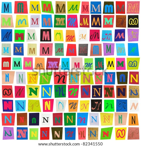 "Colorful newspaper alphabet of the letters ""M"" and ""N"" isolated on white - stock photo"